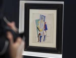 "Photo - FILE - In this Thursday, Dec. 12, 2013, file photo, Picasso's 1914 cubist drawing ""L'homme au Gibus,"" or ""Man in the Opera Hat,"" is presented at Sotheby's auction house in Paris. A Pennsylvania man looking for art for his new home has won the $1 million Picasso painting with a $138 raffle ticket.  (AP Photo/Remy de la Mauviniere, File)"