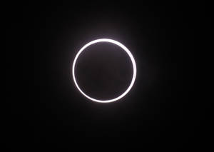Photo -   An annular solar eclipse is seen in the sky over Yokohama near Tokyo Monday, May 21, 2012. The annular solar eclipse, in which the moon passes in front of the sun leaving only a golden ring around its edges, was visible to wide areas across the continent Monday morning. (AP Photo/Koji Sasahara)