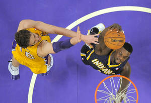 Photo - Indiana Pacers guard Lance Stephenson, right, goes up for a dunk as Los Angeles Lakers center Pau Gasol, of Spain, defends during the first half of an NBA basketball game, Tuesday, Jan. 28, 2014, in  Los Angeles. (AP Photo/Mark J. Terrill)