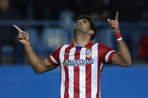 Photo - Atletico's Diego Costa celebrates his goal during a Spanish La Liga soccer match between Atletico Madrid and Granada at the Vicente Calderon stadium in Madrid, Spain, Wednesday, March 26, 2014. (AP Photo/Andres Kudacki)