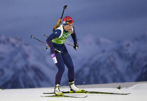 Photo - Norway's Tiril Eckhoff skis during the mixed biathlon relay at the 2014 Winter Olympics, Wednesday, Feb. 19, 2014, in Krasnaya Polyana, Russia. (AP Photo/Felipe Dana)