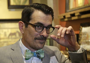 Photo - Modern Family actor Ty Burrell looks on during an interview Thursday, June 19, 2014, in Salt Lake City. Burrell is headlining a fundraiser in Salt Lake City on Thursday, an event staged by an organization that helps pay for the legal costs of challenging same-sex marriage bans. (AP Photo/Rick Bowmer)