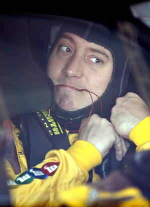 Photo -   Driver Kyle Busch prepares for a practice session, Friday, June 29, 2012, for Saturday night's NASCAR Sprint Cup Series auto race at Kentucky Speedway in Sparta, Ky. (AP Photo/James Crisp)