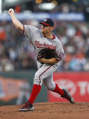 Photo - Washington Nationals pitcher Stephen Strasburg winds up during the first inning of a baseball game against the San Francisco Giants, Monday, June 9, 2014, in San Francisco, Calif. (AP Photo/Beck Diefenbach)