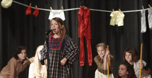 "Photo - Emma Mowry sings a song from ""Annie"" during the fifth-grade musical at Chisholm Elementary."
