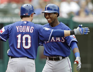 Photo -   Texas Rangers' Jurickson Profar, right, is greeted by Michael Young (10) after a solo home run off Cleveland Indians starting pitcher Zach McAllister in the third inning of a baseball game on Sunday, Sept. 2, 2012, in Cleveland. Profar hit the home run in his first major league at-bat. (AP Photo/Mark Duncan)