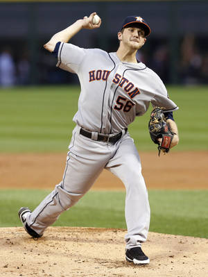 Photo - Houston Astros starting pitcher Paul Clemens delivers during the first inning of a baseball game against the Chicago White Sox Tuesday, Aug. 27, 2013, in Chicago. (AP Photo/Charles Rex Arbogast)