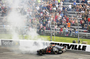 Photo - Kurt Busch exits his car after hitting the wall in the first turn during the STP 500 NASCAR Sprint Cup series auto race at Martinsville Speedway in Martinsville, Va., Sunday, April 7, 2013. (AP Photo/Don Petersen)