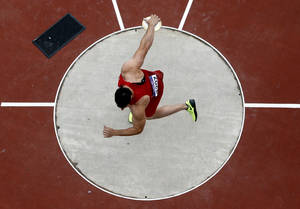Photo - United States' Lance Brooks competes in the men's discus qualification Monday during the 2012 Summer Olympics at Olympic Stadium in London.
