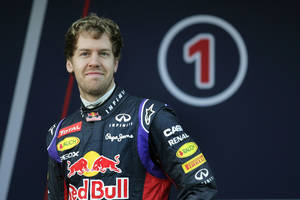 Photo - Infiniti Red Bull Racing driver Sebastian Vettel of Germany attends the launch of his new RB10 Formula One car at the Circuito de Jerez on Tuesday, Jan. 28, 2014, in Jerez de la Frontera, Spain. (AP Photo/Miguel Angel Morenatti)
