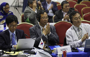 Photo -   Representatives from South Korea attend a meeting on the last day of the 64th annual International Whaling Commission meeting in Panama City, Friday, July 6, 2012.The United States says it doesn't support a South Korean plan to restart whale hunting for purportedly scientific purposes. South Korea made public its intention to revive whaling at the annual meeting this week. (AP Photo/Arnulfo Franco)