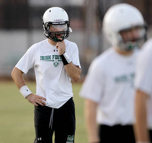 Photo - HIGH SCHOOL FOOTBALL: Bishop McGuinness quarterback Camden Tharp stands during football practice in Oklahoma City, Wednesday, August 10, 2011. Photo by Bryan Terry, The Oklahoman ORG XMIT: KOD