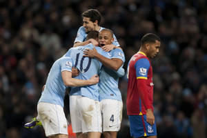 Photo - Manchester City's Edin Dzeko, second left, celebrates with teammates after scoring against Crystal Palace during their English Premier League soccer match at the Etihad Stadium, Manchester, England, Saturday Dec. 28, 2013. (AP Photo/Jon Super)