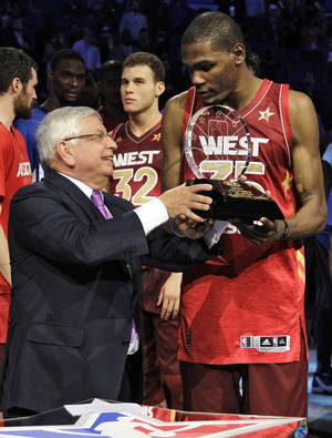 Photo - Commissioner David Stern presents the Most Valuable Player trophy to Western Conference's Kevin Durant (35), of the Oklahoma City Thunder, after the NBA All-Star basketball game, Sunday, Feb. 26, 2012, in Orlando, Fla. The Western Conference won 152-149. (AP Photo/Chris O'Meara) ORG XMIT: DOA145