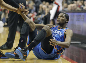Photo - Kevin Durant scored 28 points in Oklahoma City's win over Portland on Thursday. AP PHOTO
