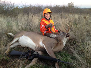 Photo - Hunter Kysela poses with the 14-point, 200-pound buck he shot in Blaine County during the youth deer season. Photo provided