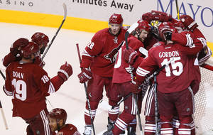 Photo -   Phoenix Coyotes' Boyd Gordon (15), Lauri Korpikoski (28), of Finland, Shane Doan (19), Oliver Ekman-Larsson, of Sweden, far right, Antoine Vermette (50), and Shane Doan (19) all celebrate with goalie Mike Smith after the third period of Game 5 in an NHL hockey Stanley Cup Western Conference semifinal playoff series against the Nashville Predators Monday, May 7, 2012, in Glendale, Ariz. The Coyotes defeated the Predators 2-1, and advance to the Western Conference finals.(AP Photo/Ross D. Franklin)