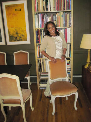photo - New York designer Elaine Griffin dresses like she decorates. Here she mixes tone and textures, pairing a satin top and cashmere sweater, and slick glossy framed chairs with velvet-upholstered seats.  Photo courtesy of Elaine Griffin