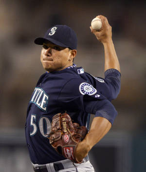 Photo -   Seattle Mariners relief pitcher Erasmo Ramirez throws to the plate during the second inning of their baseball game against the Los Angeles Angels, Tuesday, Sept. 25, 2012, in Anaheim, Calif. (AP Photo/Mark J. Terrill)