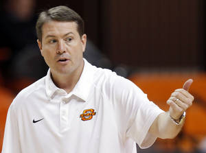 Photo - OSU head coach Travis Ford gives instructions to his team during men's college basketball practice for the Oklahoma State University Cowboys inside Gallagher-Iba Arena in Stillwater, Okla., Thursday, Oct. 27, 2011.  Photo by Nate Billings, The Oklahoman ORG XMIT: KOD