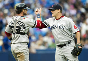 Photo -   Boston Red Sox pitcher Andrew Bailey and catcher Jarrod Saltalamacchia celebrate after defeating the Toronto Blue Jays during their baseball game in Toronto on Saturday, Sept. 15, 2012. (AP Photo/The Canadian Press, Frank Gunn)