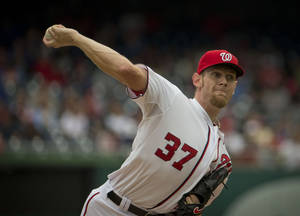 Photo - Washington Nationals starting pitcher Stephen Strasburg (37) throw against the Los Angeles Dodgers during the first inning of a baseball game, Wednesday, May 7, 2014 in Washington. (AP Photo/Pablo Martinez Monsivais)