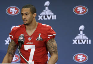 photo - San Francisco 49ers quarterback Colin Kaepernick talks with reporters during a news conference on Wednesday, Jan. 30, 2013, in New Orleans. The 49ers are scheduled to play the Baltimore Ravens in the NFL Super Bowl XLVII football game on Feb. 3. (AP Photo/Mark Humphrey)