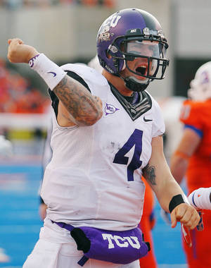 Photo - TCU quarterback Casey Pachall celebrates a two-point conversion during the second half of an NCAA college football game against Boise State, Saturday, Nov. 12, 2011, in Boise, Idaho. TCU won 36-35. (AP Photo/The Times-News, Drew Nash) MANDATORY CREDIT ORG XMIT: IDTWF102