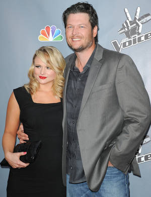 "Photo - Miranda Lambert, left, and Blake Shelton arrive at the 4th season premiere screening of ""The Voice"" at the TCL Theatre on Wednesday, March 20, 2013 in Los Angeles. (Photo by Richard Shotwell/Invision/AP)"