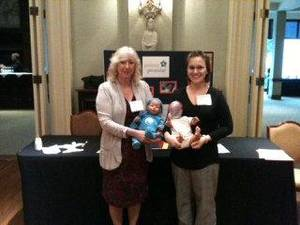 Photo - Billie Brown, Parent Promise executive director, and Sarah  Njuguna, Family Support Worker, attend an outreach event highlighting the organization's shaken baby prevention program.  Photo provided.   <strong></strong>