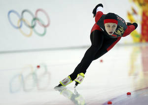Photo - Gold medalist China's Zang Hong competes in the women's 1,000-meter speedskating race at the Adler Arena Skating Center during the 2014 Winter Olympics in Sochi, Russia, Thursday, Feb. 13, 2014. (AP Photo/Pavel Golovkin)