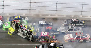 photo -   Tony Stewart (14) flips over as Kasey Kahne (5), Clint Bowyer (15), Dave Blaney (36), Terry Labonte (32), Regan Smith (78), Jeff Burton (31), Jimmie Johnson (48), Dale Earnhardt Jr. (88), Paul Menard (27) and David Ragan (34) crash around him during the NASCAR Sprint Cup Series auto race at Talladega Superspeedway in Talladega, Ala., Sunday, Oct. 7, 2012. (AP Photo/Dale Davis)  
