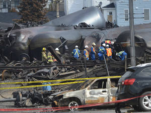 Photo - Emergency workers examine the aftermath of a train derailment and fire July 6 in Lac-Megantic, Quebec.    AP File Photo <strong>Ryan Remiorz - AP</strong>