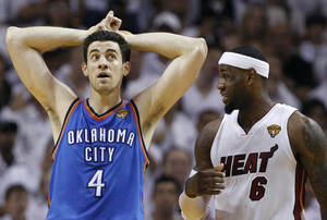 photo - Oklahoma City Thunder power forward Nick Collison (4) and Miami Heat small forward LeBron James (6) react during the second half at Game 3 of the NBA Finals basketball series, Sunday, June 17, 2012, in Miami. (AP Photo/Lynne Sladky)