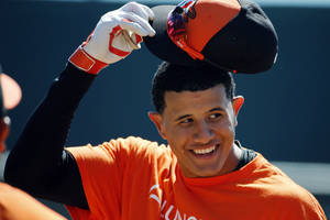 Photo - Baltimore Orioles' Manny Machado takes off his hat before going into the batting cage to hit before an exhibition spring training baseball game against the Boston Red Sox in Sarasota, Fla., Saturday, March 8, 2014. (AP Photo/Gene J. Puskar)