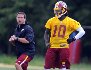 Photo - FILE - In this Aug. 16, 2012, file photo, Washington Redskins quarterback coach Matt LaFleur, left, works with quarterback Robert Griffin III during NFL football training camp in Ashburn, Va. Notre Dame head football coach Brian Kelly announced Friday, Jan. 24, 2014, that they hired LaFleur as the team's new quarterbacks coach. (AP Photo/Richard Lipski, File)