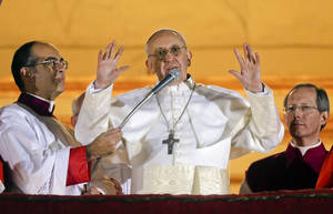Photo - FILE -- In this file photo taken on March 13, 2013, Pope Francis waves to the crowd from the central balcony of St. Peter's Basilica at the Vatican, the day of his election. From his gestures to his simple soundbites to his emphasis that priests are called to serve, Pope Francis has endeared himself to the public, radically shifted the paradigm of the papacy and reminded the world that the church's mission is one of mercy. (AP Photo/Gregorio Borgia)