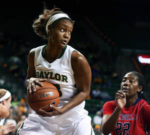 Photo - Baylor forward Nina Davis pulls down a rebound in front of Mississippi's Danielle McCray, right, during the first half of an NCAA college basketball game, Wednesday, Dec. 18, 2013, in Waco, Texas. (AP Photo/Waco Tribune Herald, Rod Aydelotte)
