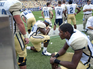 Photo -   Georgia Tech players react to their loss against Middle Tennessee State in the fourth quarter of an NCAA college football game on Saturday, Sept. 29, 2012, in Atlanta. (AP Photo/Rich Addicks)