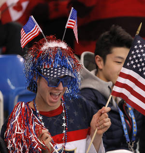 Photo - Jason Brown of the United States watches the women's short program figure skating competition at the Iceberg Skating Palace during the 2014 Winter Olympics, Wednesday, Feb. 19, 2014, in Sochi, Russia. (AP Photo/Vadim Ghirda)