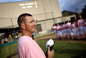 Photo - WEAR / WEARING PINK / GIRLS HIGH SCHOOL SOFTBALL: Volunteer coach Matt Allen stands on the field before a Bishop McGuinness softball game in Oklahoma City, Tuesday, Sept. 14, 2011.  Allen was diagnosed with brain cancer two years ago and continues his volunteer coaching duties with the softball team. Win-Win Week is a statewide effort by Oklahoma high schools to support cancer awareness. Photo by Bryan Terry, The Oklahoman ORG XMIT: KOD