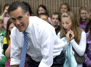 Photo -   Republican presidential candidate, former Massachusetts Gov. Mitt Romney poses for photographs with students of Fairfield Elementary School, Monday, Oct. 8, 2012, in Fairfield, Va. (AP Photo/ Evan Vucci)