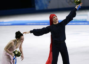 Photo - Tessa Virtue and Scott Moir of Canada celebrate placing second in the ice dance free dance figure skating finals at the Iceberg Skating Palace during the 2014 Winter Olympics, Monday, Feb. 17, 2014, in Sochi, Russia. (AP Photo/Bernat Armangue)