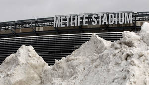 Photo - In this Dec. 15, 2013 file photo, a mound of snow is shown outside of MetLife Stadium before an NFL football game between the Seattle Seahawks and the New York Giants, in East Rutherford, N.J. NFL officials may be embracing the notion of a cold-weather Super Bowl, but seriously: What happens if there is, in fact, a snow storm on Feb. 2? (AP Photo/Peter Morgan, File)