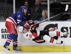 Photo -   New York Rangers' Brandon Prust (8) and Ottawa Senators' Erik Karlsson (65) collide during the second period of Game 2 of a first-round NHL hockey playoff series Saturday, April 14, 2012, in New York. (AP Photo/Frank Franklin II)