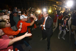 photo - New Auburn football coach Gus Malzahn greets fans at an airport Tuesday, Dec. 4, 2012, in Auburn, Ala. (AP Photo/Todd J. Van Emst)