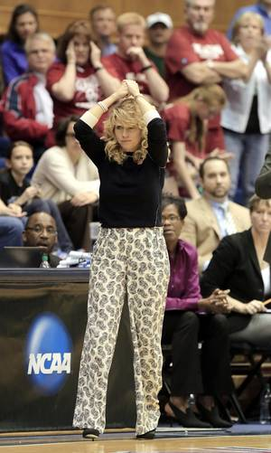 Photo - Oklahoma coach Sherri Coale watches from the sideline during the second half of her team's 104-100 loss to DePaul in a first-round game at the NCAA basketball tournament in Durham, N.C., Saturday, March 22, 2014.  (AP Photo/Ted Richardson)