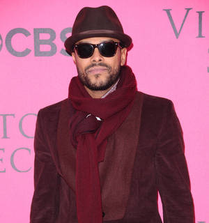 Photo -   FILE - In this November 9, 2011 file photo, Maxwell attends the Victoria's Secret fashion show in New York. The R&B singer canceled his six-date 2012 summer tour after developing a definitive vocal cord edema and a vocal cord hemorrhage. (AP Photo/Peter Kramer, File)