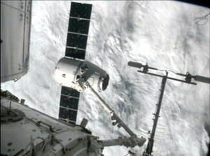 photo -   This image from NASA-TV shows the capture of the Dragon capsule by a robot arm on the International Space Station as they passed over the South Atlantic Ocean early Wednesday Oct. 10, 2012. It's the first official delivery by the California-based SpaceX company under a $1.6 billion contract with NASA. The contract calls for 12 such shipments. (AP Photo/NASA)