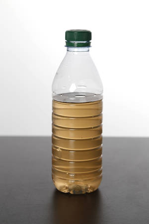 Photo - Water from the tap in Stillwater has a brown color to it. Tuesday, September 10, 2013. Photo by Doug Hoke, The Oklahoman